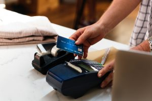 credit card machine with blue credit card swiping